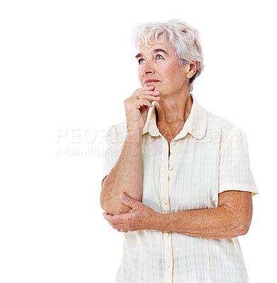Buy stock photo Studio shot of a thoughtful-looking elderly woman isolated on white