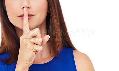 Buy stock photo Cropped shot of a young woman with her finger on her lips
