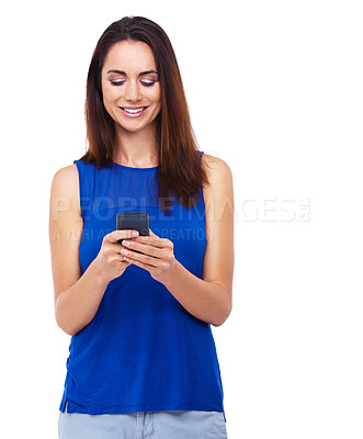 Buy stock photo Shot of an atrractive young woman sending a text message against a white background