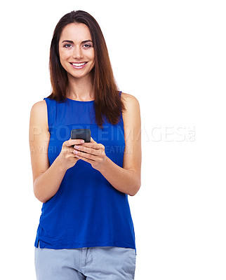 Buy stock photo Portrait of an atrractive young woman sending a text message against a white background