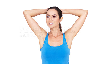Buy stock photo Portrait of a sporty young woman standing with her hands behind her head