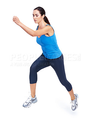 Buy stock photo Full length shot of an attractive young woman running against a white background