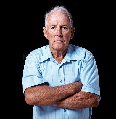 Buy stock photo Studio portrait of a grumpy-looking elderly man against a gray background
