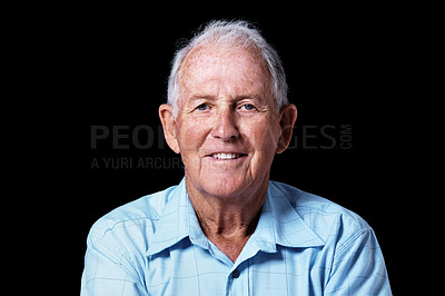 Buy stock photo Studio portrait of a content-looking elderly man isolated on black