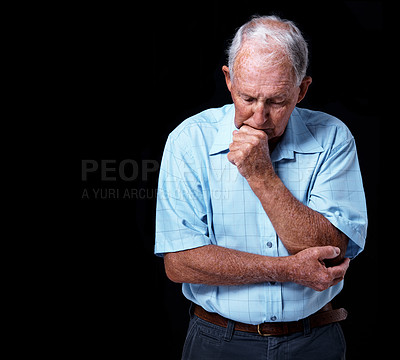 Buy stock photo Studio shot of a sad-looking elderly man isolated on black