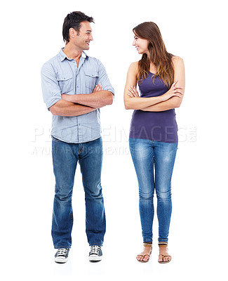 Buy stock photo Shot fo a couple in casual clothing crossing their arms and smiling at each other