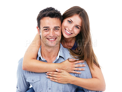Buy stock photo Shot of man giving a pretty girl a piggyback against a white background- Studio Shot