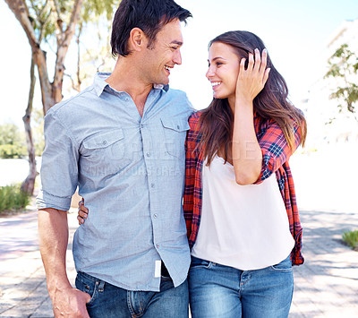 Buy stock photo Shot of a loved up couple going for a romantic walk