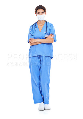 Buy stock photo Shot of a nurse with her arms crossed and a surgical mask on