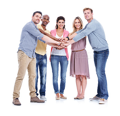 Buy stock photo Five positive coworkers putting their hands in together while smiling and isolated on white