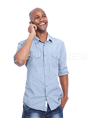 Buy stock photo A smiling african american man using his smartphone while isolated on white