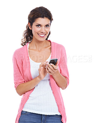 Buy stock photo An attractive brunette smiling and using her mobile while isolated on white