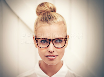 Buy stock photo A young woman with her hair in a bun