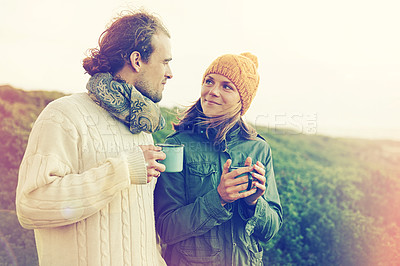 Buy stock photo Cropped shot of an affectionate young couple standing together outdoors