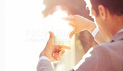 Buy stock photo Over the shoulder shot of a businessman framing a city scene with his hands