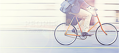 Buy stock photo Cropped shot of a man riding his bicycle through the city