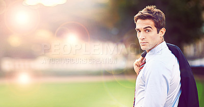 Buy stock photo Shot of a handsome and stylish businessman in a city park