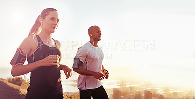 Buy stock photo Shot of a young couple out for an early morning run