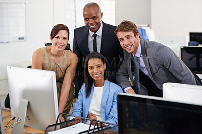 Buy stock photo Portrait of a group of businesspeople working around a computer