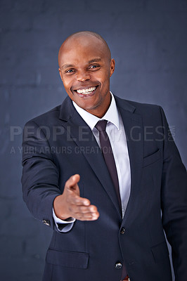 Buy stock photo Portrait of a successful young businessman offering you his hand