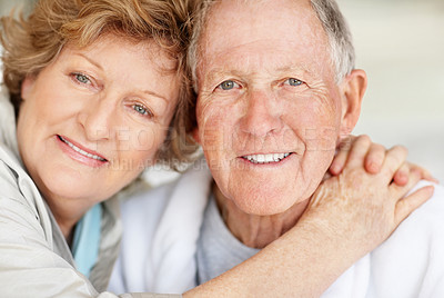 Buy stock photo Portrait of a senior man being held loving by his wife