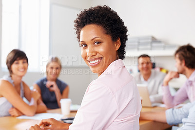 Buy stock photo Happy woman smiling with colleagues discussing in meeting
