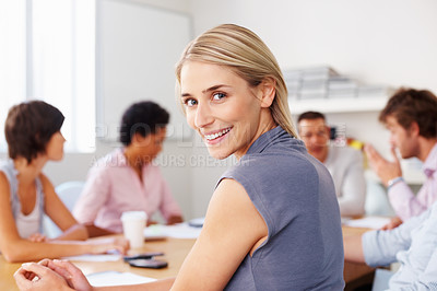 Buy stock photo Happy young woman smiling in business meeting