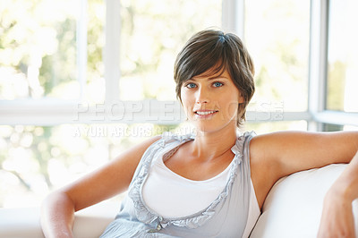 Buy stock photo Portrait of happy pretty woman relaxing on couch