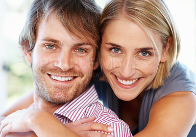 Buy stock photo Closeup portrait of a happy young woman embracing her boyfriend