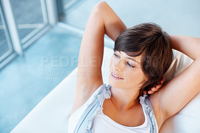 Buy stock photo Pretty woman relaxing on sofa and looking away