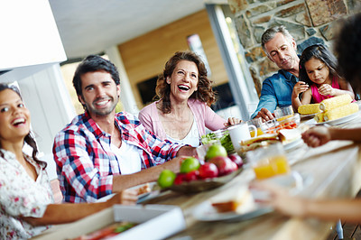 Buy stock photo A happy family enjoying a meal time together