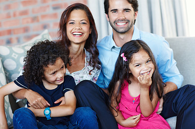 Buy stock photo A fun loving family sitting on the couch together
