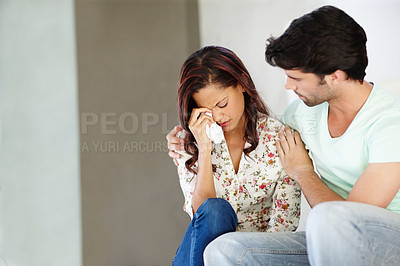 Buy stock photo A young couple dealing with the difficulties of life