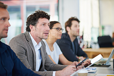 Buy stock photo Cropped shot of business people around a table in a meeting