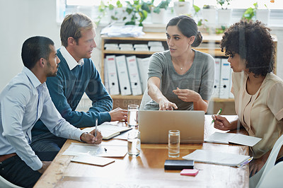 Buy stock photo Shot of a group of professionals using wireless technology during a meeting