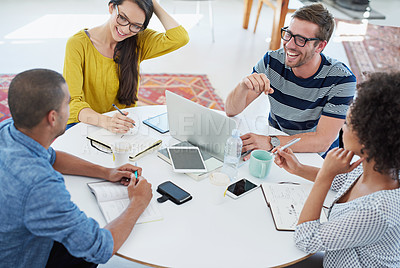 Buy stock photo Shot of a group of designers at work in an office
