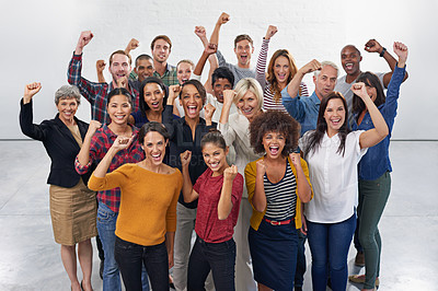 Buy stock photo A group of colleagues punching the air together