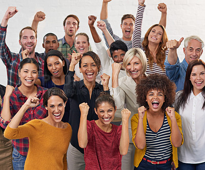 Buy stock photo Shot of a group of colleagues punching the air