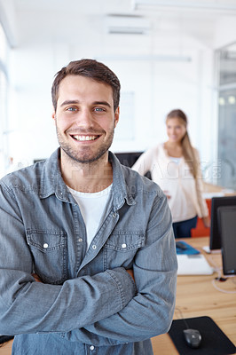 Buy stock photo Portrait of a young design professional with a female colleague standing in the background