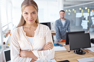 Buy stock photo Portrait of a attractive young design professional with a male colleague standing in the background
