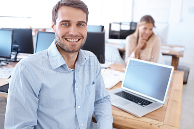 Buy stock photo Portrait of two positive-looking young designers working in the office