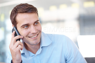Buy stock photo Closeup shot of a handsome young business professional talking on a cellphone