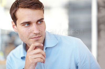 Buy stock photo Handsome young man looking contemplatively out of the frame - copyspace