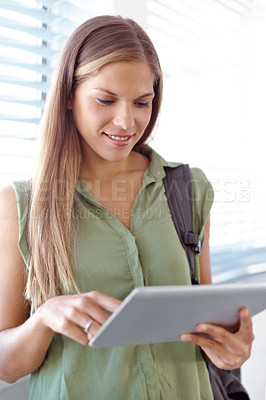 Buy stock photo Beautiful young student working on a digital tablet - closeup