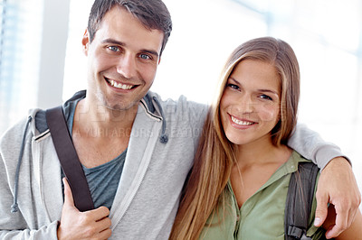 Buy stock photo Young student with his arm around his colleague smiling at the camera