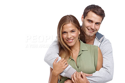 Buy stock photo Happy young boyfriend embracing his girlfriend from behind