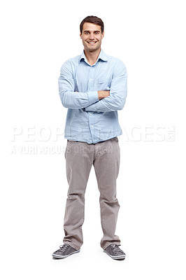 Buy stock photo Handsome young man standing with his arms folded and smiling at the camera - portrait