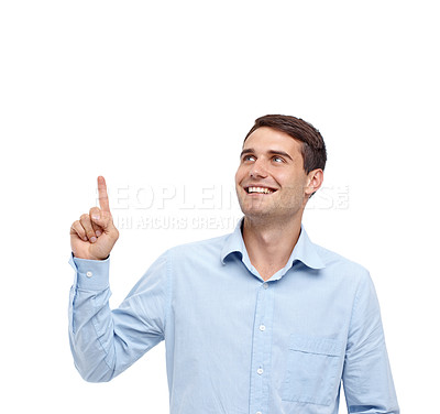 Buy stock photo Handsome young smiling man pointing up at copyspace - isolated