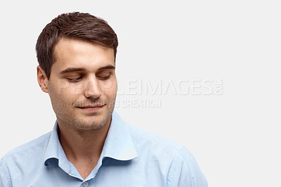 Buy stock photo Closeup of a handsome young man looking down