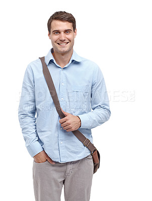 Buy stock photo Handsome young man wearing a satchel and smiling at the camera - isolated